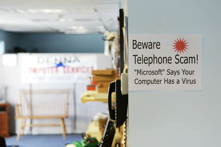 Telephone scam warning signs hang inside DENNA Computer Services in Brookfield, Conn. on Friday, Sept. 20, 2013.  The owners have been dealing with many customers who are the victims of phone scams invloving computers and have spoken out on the issue.Here are tips to avoid being scammed... Photo: Tyler Sizemore / Tyler Sizemore / The News-Times