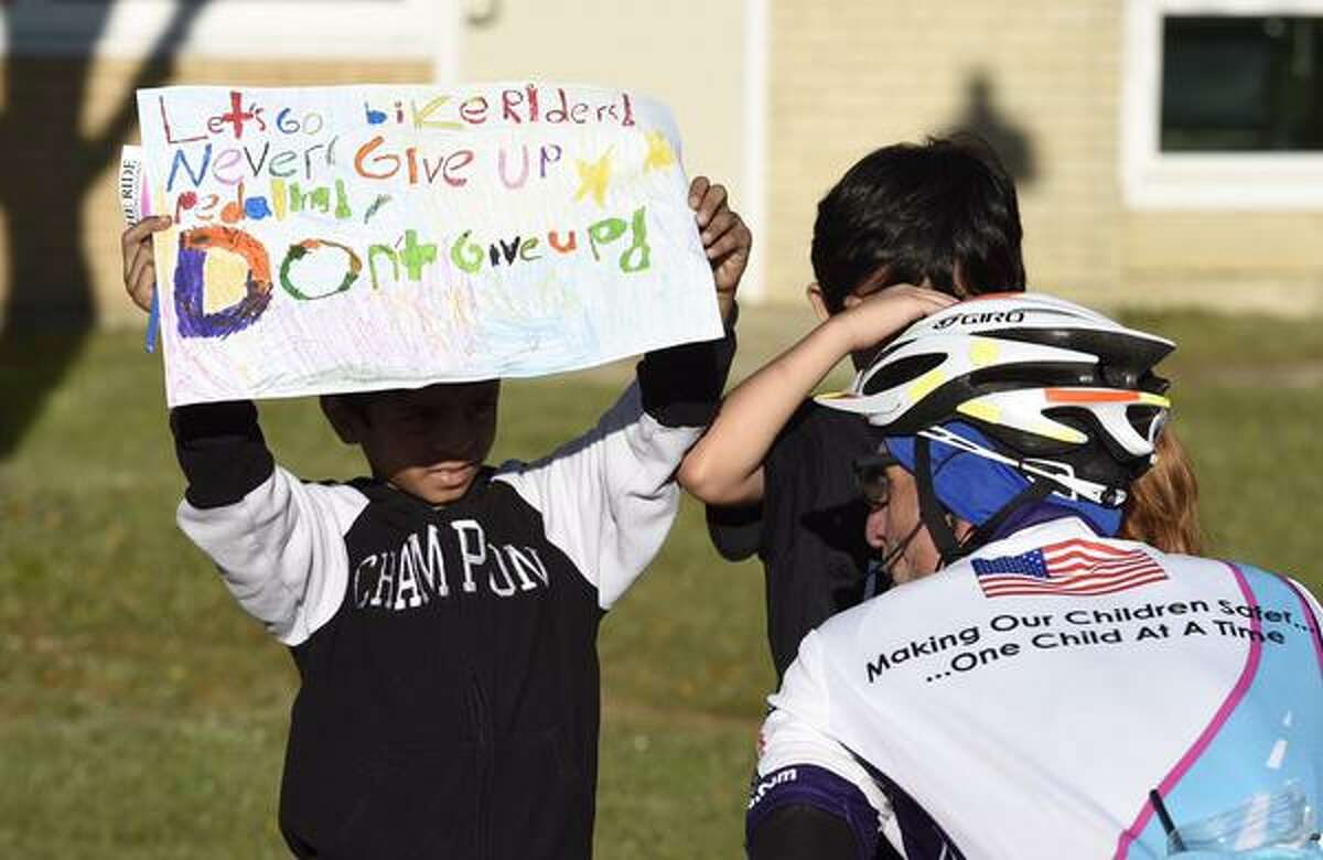 Children prepare to greet police officers on bikes who are pedaling through Albany, Schenectady, and Saratoga counites on Friday to raise awarenewss about missing children. (Skip Dickstein / Times Union)