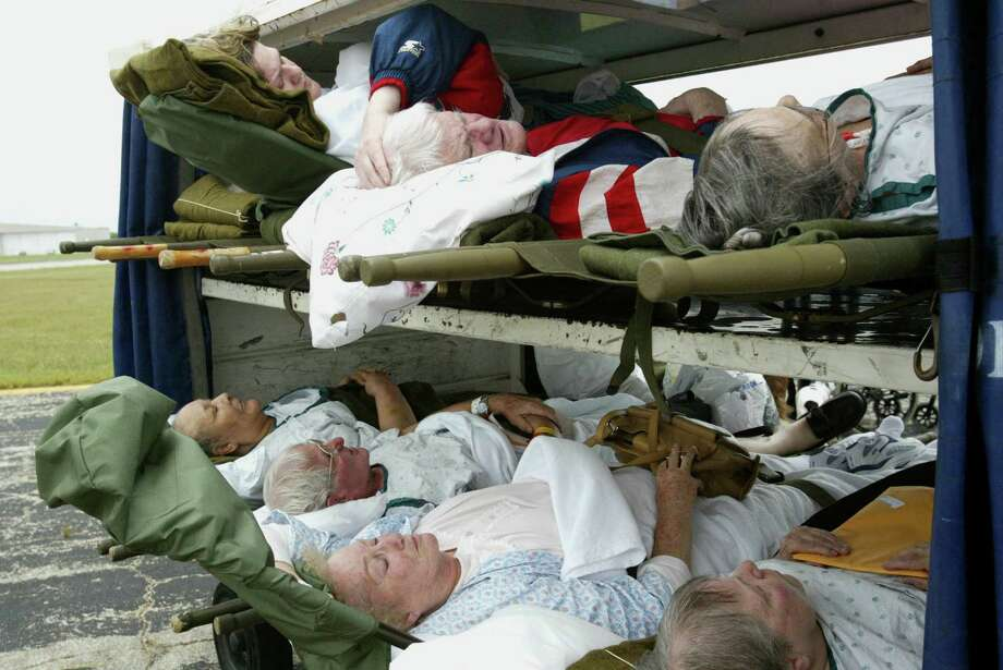 Nursing home and hospital patients are placed in baggage carriers before they are boarded onto C-141 plane at South Texas Regional Airport Friday, Sept. 23, 2005 in Port Authur. The U.S. Army evacuated patients before Hurricane Rita made landfall onto Jefferson County.  Mayra Beltran/Houston Chronicle Photo: MAYRA BELTRAN, MBR / 2005 AP