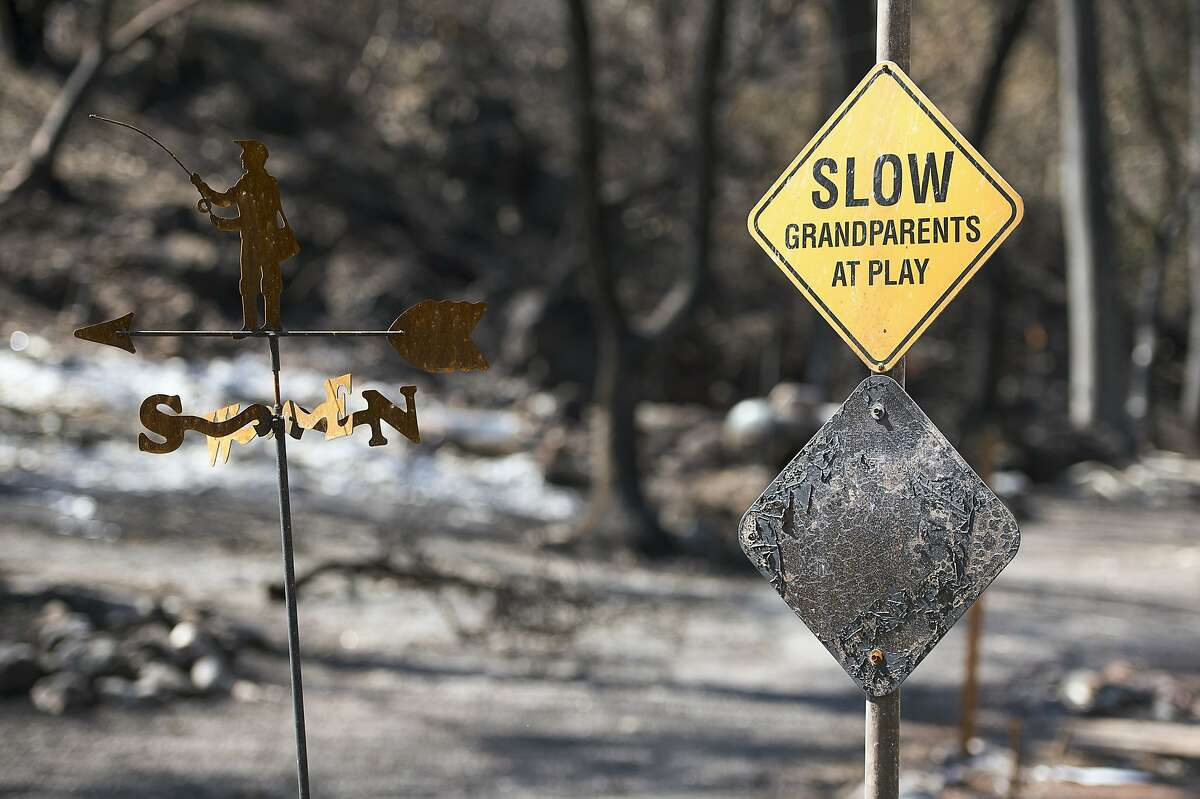 A scorched sign and homes remain on Thursday Sept. 17, 2015 in Anderson Springs, Calif. The Valley Fire that sped through Middletown and other parts of rural Lake County, less than 100 miles north of San Francisco, has continued to burn since Saturday despite a massive firefighting effort.