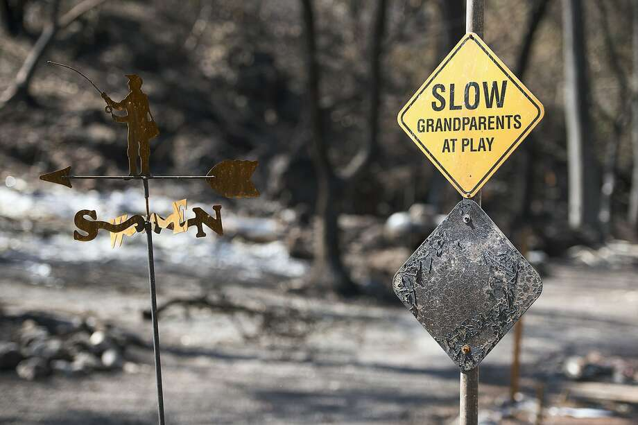 A scorched sign and homes remain on Thursday Sept. 17, 2015 in Anderson Springs, Calif.  The Valley Fire that sped through Middletown and other parts of rural Lake County, less than 100 miles north of San Francisco, has continued to burn since Saturday despite a massive firefighting effort. Photo: Paul Kitagaki Jr., Associated Press