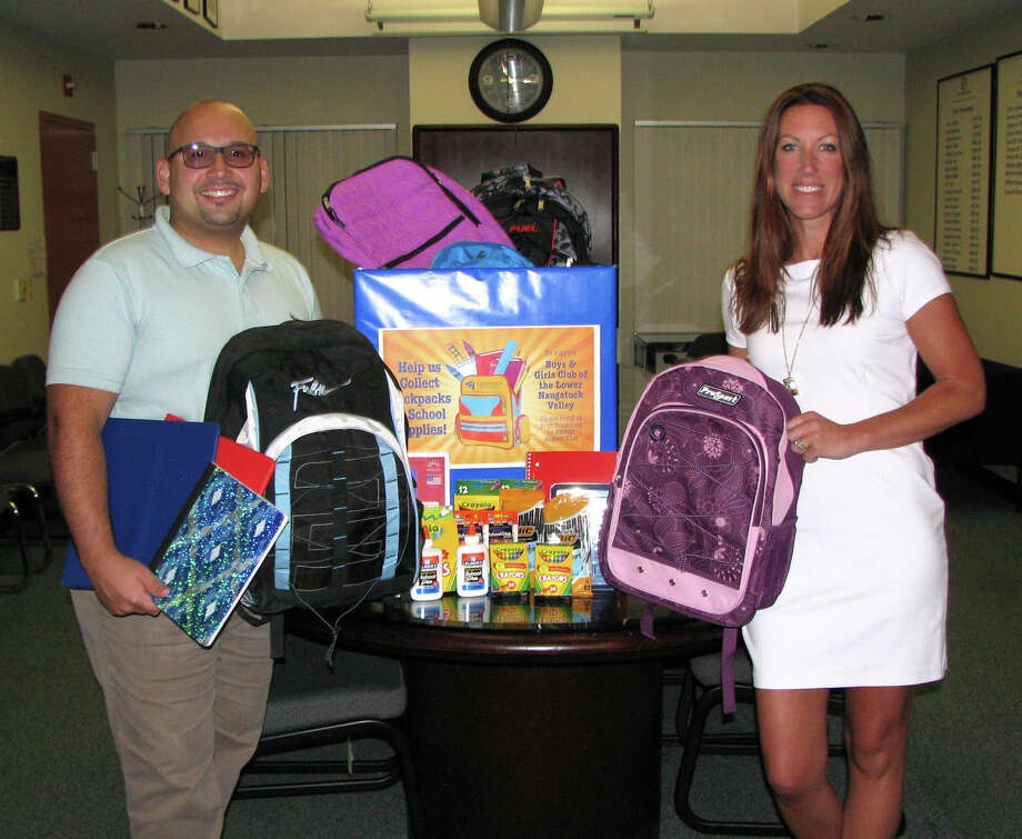 Sikorsky Credit Union members helped out families with children going back to school by donating school supplies at several branches, with items going directly to community organizations. Pictured are Paolo Mancuso, the Shelton branch manager, left, and Shaye Roscoe, executive director of the Boys & Girls Club of the Lower Naugatuck Valley. Photo: Contributed Photo / Connecticut Post / Connecticut Post