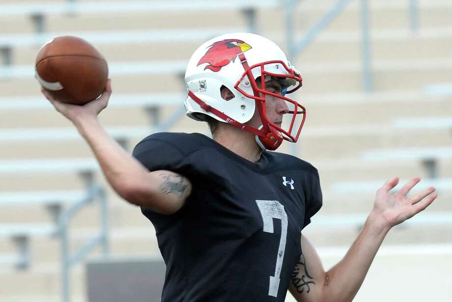 Lamar's Brett Cox throws passes during practice at Cardinal Stadium on Wednesday.  Photo taken Tuesday, September 15, 2015  Guiseppe Barranco/The Enterprise Photo: Guiseppe Barranco, Photo Editor