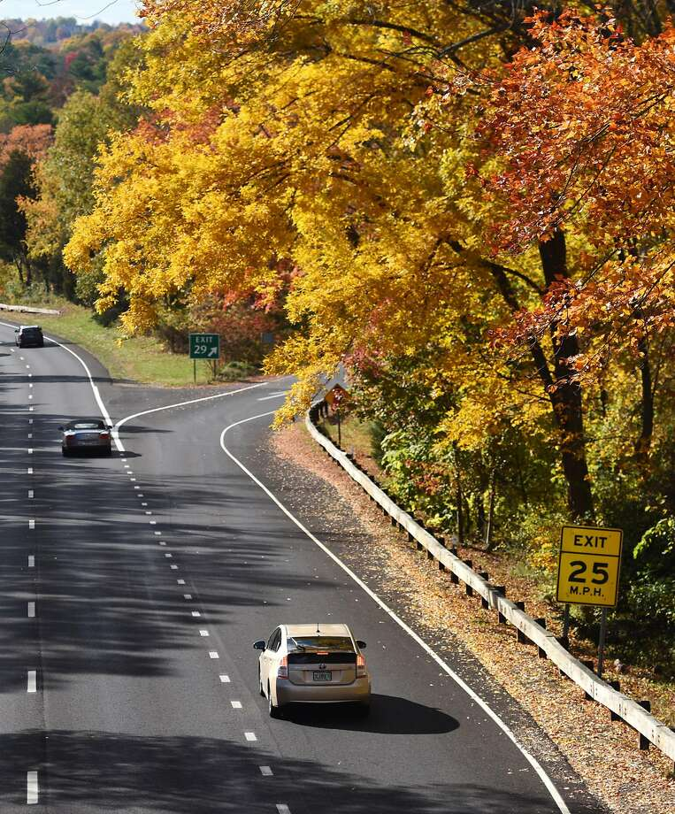 Traffic passes underneath beautiful yellow and orange foliage by the Lake Avenue exit along the Merritt Parkway in Greenwich, Conn. Thursday, Oct. 30, 2014.  According the the Connecticut DEEP, peak foliage in the Greenwich area is approaching and expected to last until mid-November. Photo: Tyler Sizemore