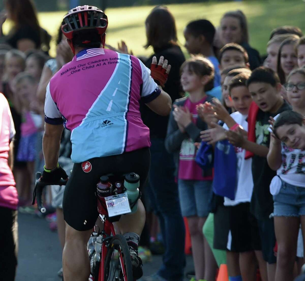 Students cheer loudly as the Ride for Missing Children makes a stop at Forts Ferry Elementary School Friday morning Sept. 19, 2015 in Colonie, N.Y. (Skip Dickstein/Times Union)