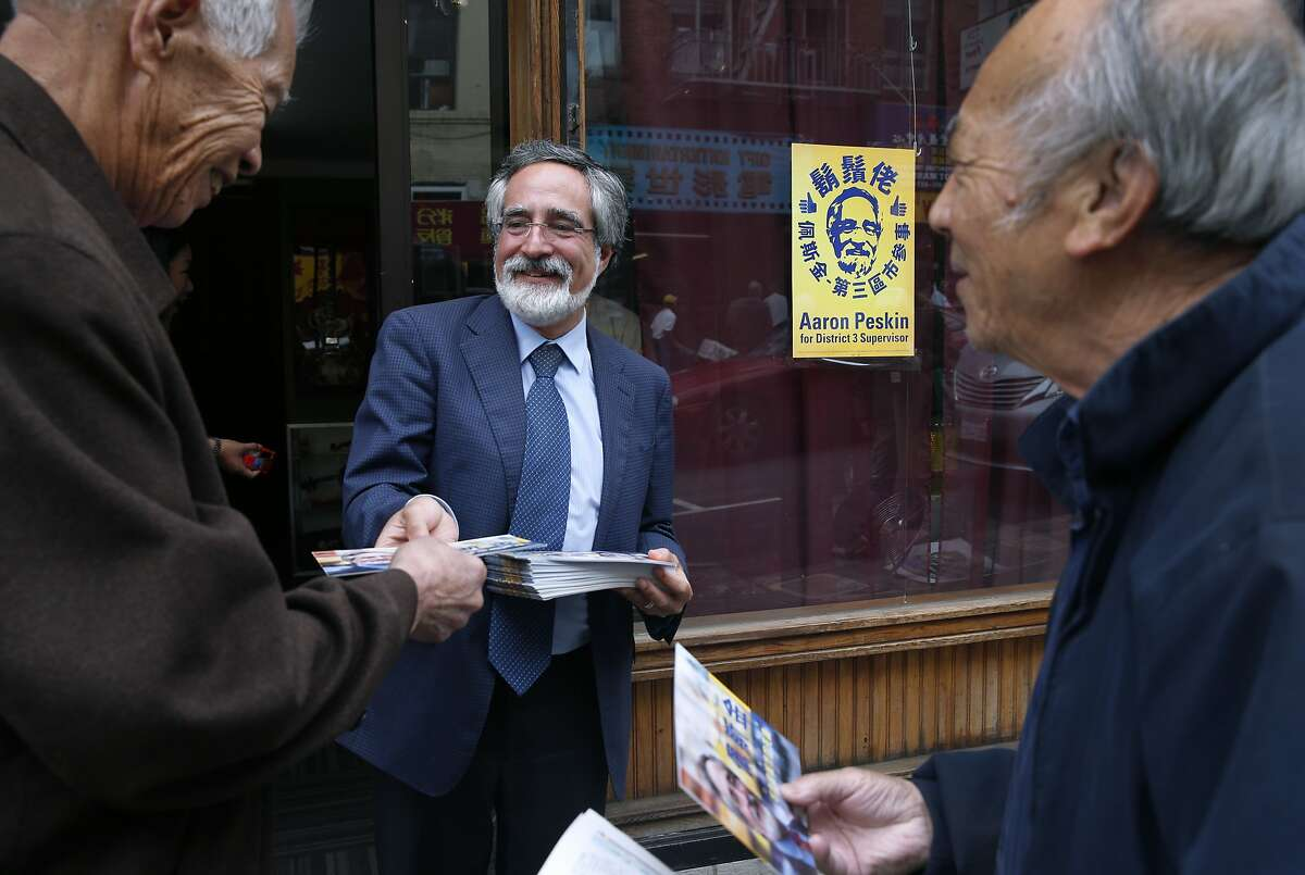 Aaron Peskin hands out campaign literature to voters on Jackson Street in Chinatown in San Francisco, Calif. on Thursday, Sept. 17, 2015. Peskin is seeking to unseat incumbent Julie Christensen in District 3 on the Board of Supervisors, a position he previously held from 2001-2009.