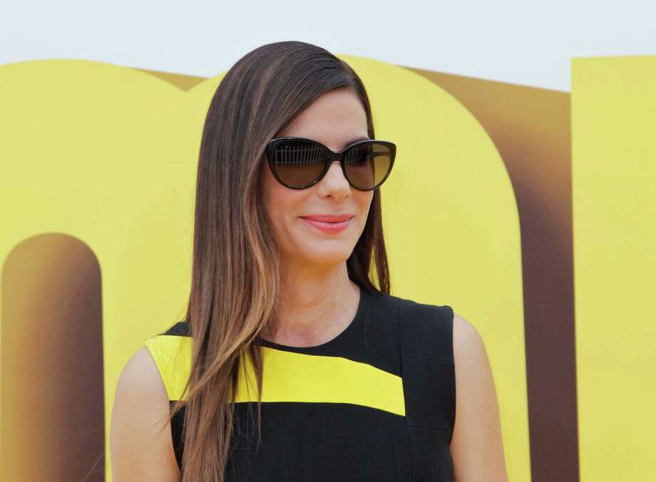 Photos: Who has come to help HoustonSandra Bullock attends the Premiere of 'Minions' at The Shrine Auditorium on June 27, 2015 in Los Angeles, California.See some of the other groups who have come from around the country to help the Bayou City. Photo: Tibrina Hobson, Getty Images / 2015 Tibrina Hobson