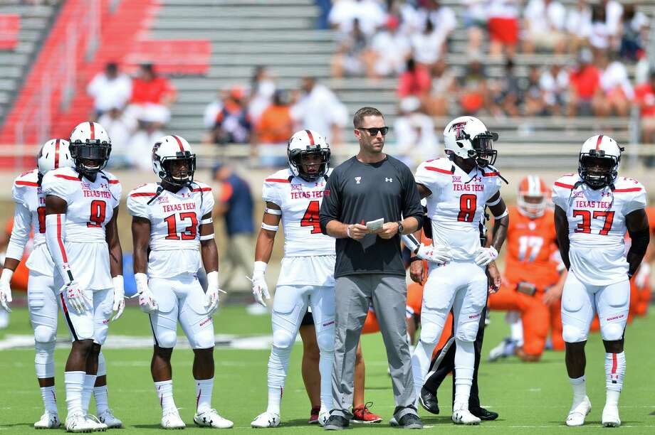 Head coach Kliff Kingsbury of the Texas Tech Red Raiders gathers his players before the game against the UTEP Miners on Sept. 12, 2015 at Jones AT&T Stadium in Lubbock. Photo: John Weast /Getty Images / 2015 Getty Images