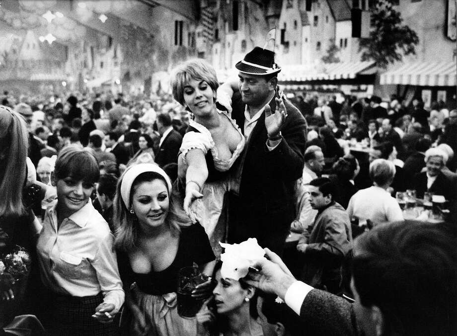 Millions descend on Munich each year for the two-week Oktoberfest, a tradition in Bavaria to the early 1800s. Beer, pretzels, lederhosen — it all kicks off this weekend, so here's a look back at Oktoberfest in Germany through the years. Photo: Ullstein Bild, Ullstein Bild Via Getty Images / ullstein bild
