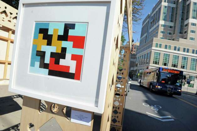 A piece by artist Douglas Holst hangs in the Albany Center Gallery's both occupying a parking space on Broadway as part of parking day on Friday Sept. 18, 2015 in Albany, N.Y.  (Michael P. Farrell/Times Union) Photo: Michael P. Farrell / 00033414A