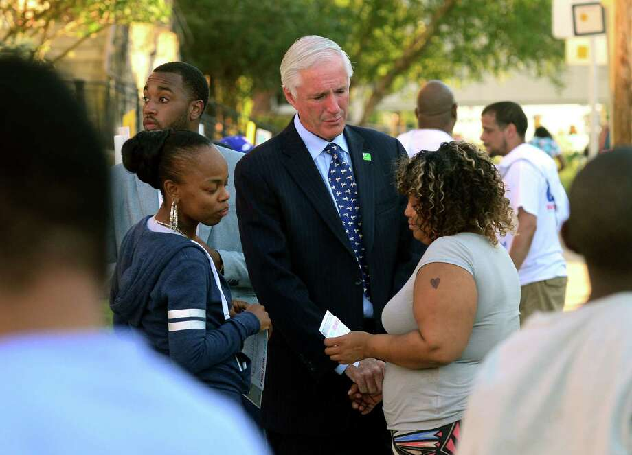 Bridgeport Mayor Bill Finch consoles Teena Alford over the sudden death of her 10-year-old daughter, Nyshell Petree, this week from asthma. Finch was at Harding High School on Wednesday campaigning on a primary election day that ended in an upset. For a few minutes Wednesday, Mayor Bill Finch drums up last-minute support at the polls at Harding High School in Bridgeport. Photo: Christian Abraham / Hearst Connecticut Media / Connecticut Post