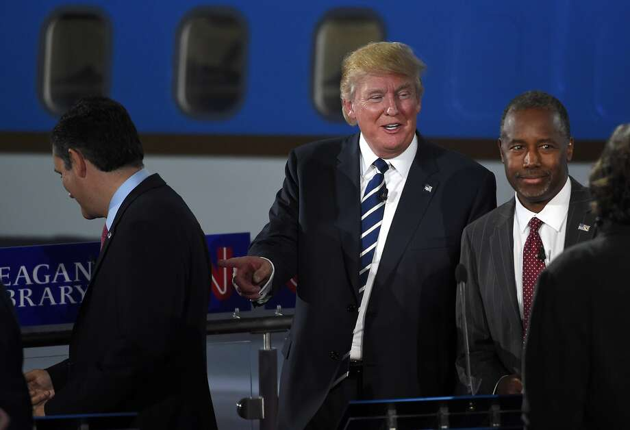 Republican presidential candidate Donald Trump, center, points toward Ted Cruz, left, as Ben Carson looks on following the CNN Republican presidential debate at the Ronald Reagan Presidential Library and Museum, Wednesday, Sept. 16, 2015, in Simi Valley, Calif. (AP Photo/Mark J. Terrill) Photo: Mark J. Terrill, Associated Press