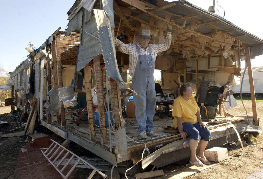 Marshall and Dianne Jackson sat in their trailer in Sabine Pass, which had been destroyed by Hurricane Rita just a month earlier.  Photo: Beaumont Enterprise