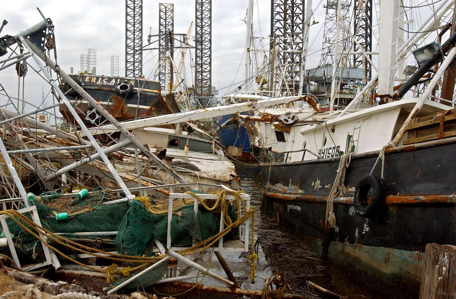 Ships on Fisherman's Warf in Sabine Pass are shown on Oct. 8, 2005, weeks after Hurricane Rita ripped through the small town. Photo: Beaumont Enterprise / © 2005 The Beaumont Enterprise