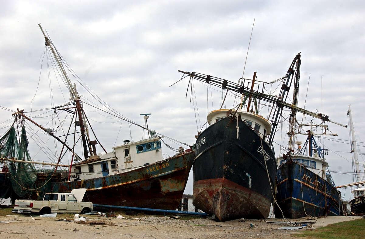 Weeks after Hurricane Rita struck, damaged shrimping boats still sat on Fisherman's Warf in Sabine Pass.