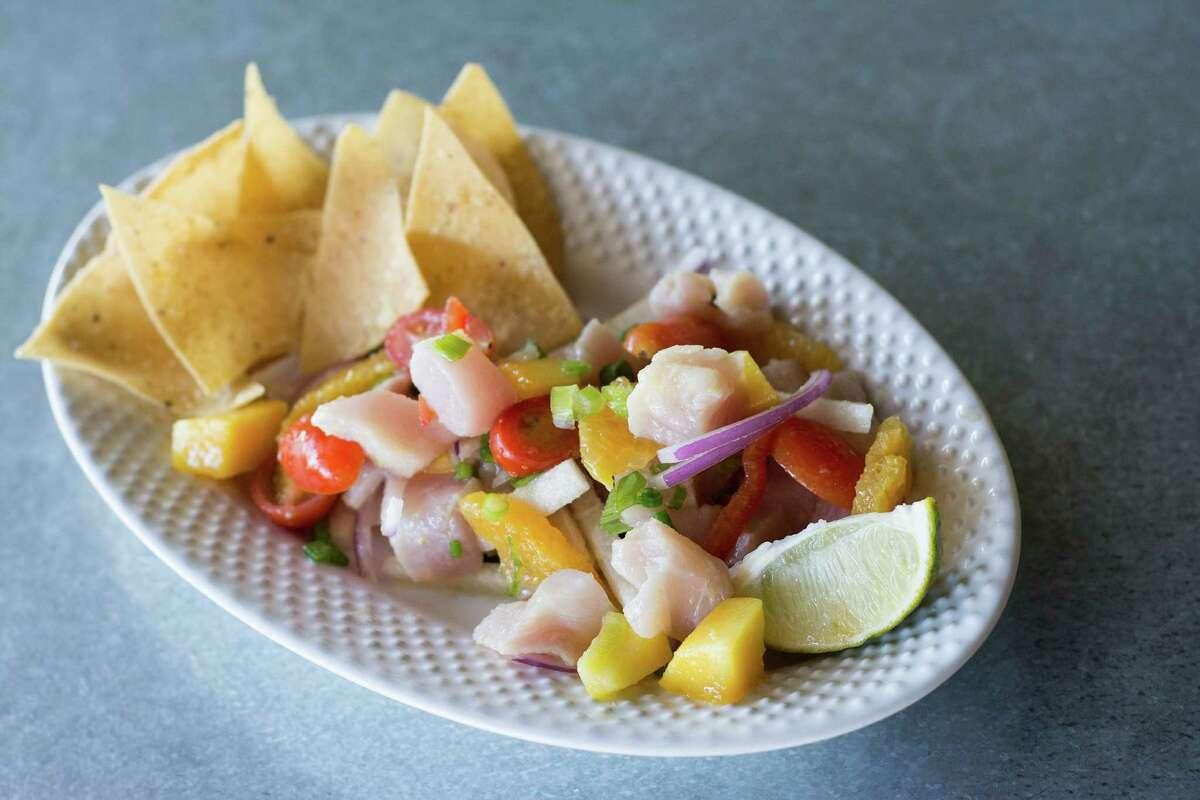 Flair's mojo citrus ceviche includes sushi grade fish, red onion, cherry tomatoes, orange supreme and cilantro.