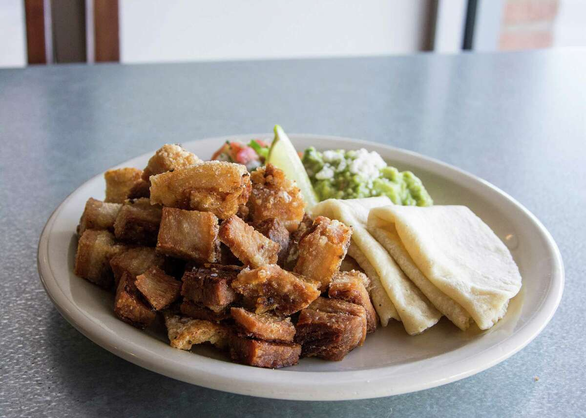 The pork belly chicharrones at Flair are fried and served with guacamole and pico de gallo.