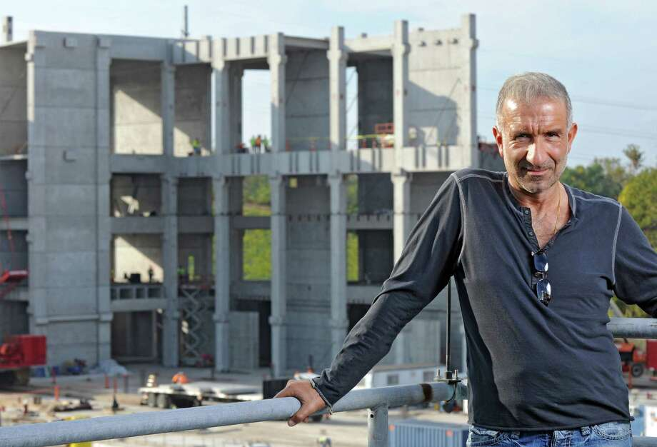 SUNY Polytechnic Institute President and CEO Alain Kaloyeros stands across from new construction on the other side of Washington Avenue Extension at the college on Tuesday Sept. 27, 2011 in Albany, NY. ( Philip Kamrass / Times Union archive) Photo: Philip Kamrass / 00014779A