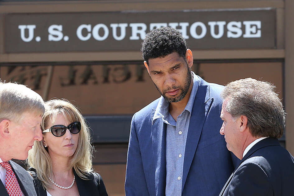 Tim Duncan consults with his legal team in June after a federal court hearing before U.S. District Judge Xavier Rodriguez regarding Duncan's lawsuit against Charles Banks. From left are attorney Jacqueline Garza-Rothrock, attorney J.Tullos Wells, consultant Wendy Kowalik, Duncan and attorney Michael D. Bernard.