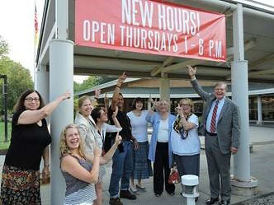 Mayor Martin joins Harry Bennett Branch Library staff in celebrating the new extended hours. Photo: Contributed / Contributed / Stamford Advocate Contributed