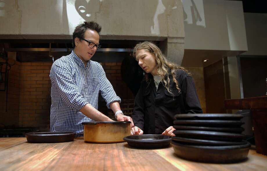 Russell Moore,(left) executive chef and owner of Camino restaurant, meets with Flameware ceramics creator Travis McFlynn, to discuss a custom order on Fri. September 18, 2015. Moore uses the custom created Flameware ceramics at his restaurant in Oakland, Calif. Photo: Michael Macor, The Chronicle