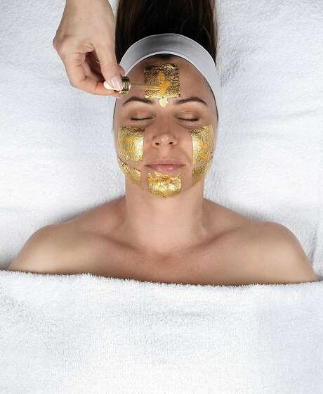 Caviar & Carat Facial with gold leaves, above, at LaBelle Day Spa in S.F.; facials start at $135. Photo: Victor Wang, LaBelle Day Spa