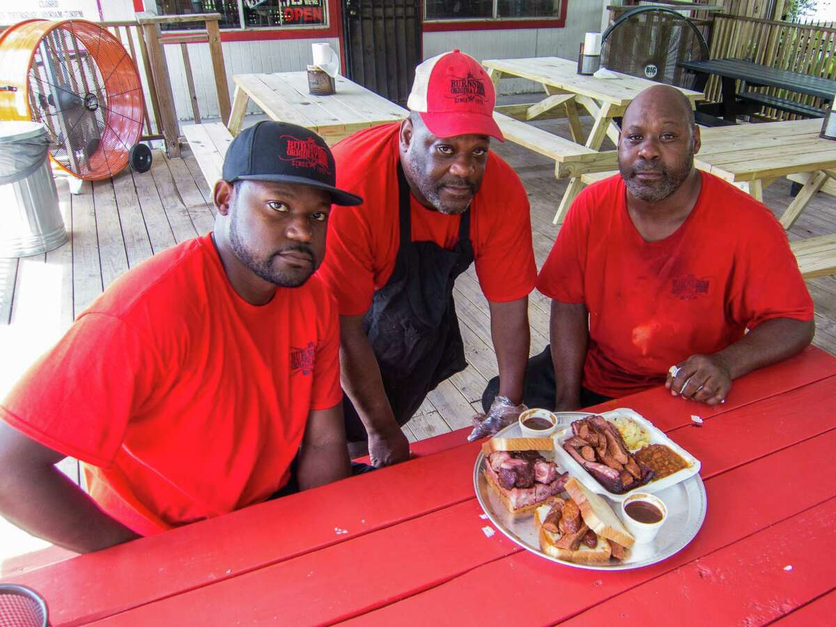 Cory Crawford, from left, Gary Burns and Steve Burns are three of the men behind Burns Original BBQ.