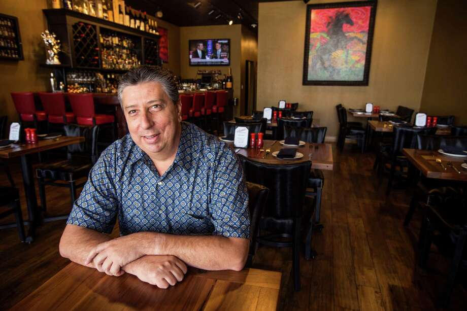 Carlos Abedrop, owner of Saltillo Mexican Kitchen, says he's using lessons learned at his previous restaurant to inform his new venture. Photo: Brett Coomer, Staff / © 2015 Houston Chronicle
