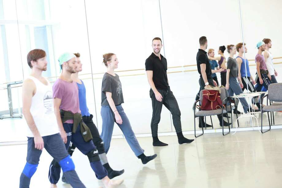 """Garrett Smith, far right in black, rehearses his new ballet """"Reveal"""" with artists of Houston Ballet. Smith wants to be a working choreographer by the time he's 30. Photo: Amitava Sarkar"""
