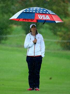 SANKT LEON-ROT, GERMANY - SEPTEMBER 18:  Juli Inkster the United States Team captain witching in the rain on the 12th hole during the Friday afternoon fourball matches in the 2015 Solheim Cup at St Leon-Rot Golf Club on September 18, 2015 in Sankt Leon-Rot, Germany.  (Photo by David Cannon/Getty Images)