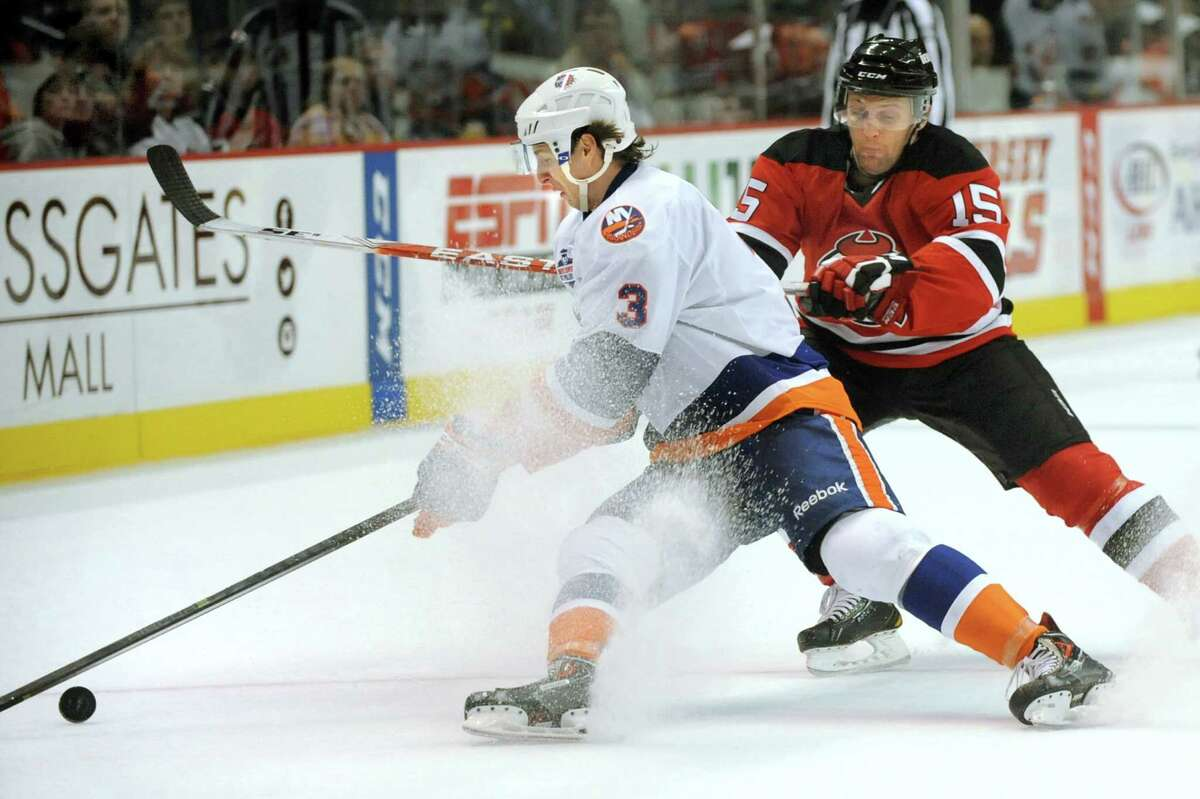 Tigers Andrey Pedan, left, controls the puck as Devils Paul Thompson defends during their hockey game on Saturday, Oct. 18, 2014, at Times Union Center in Albany, N.Y. (Cindy Schultz / Times Union)
