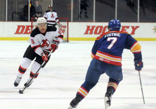 Devil's right winger Paul Thompson brings the puck up the ice during their hockey game against the Admirals at the Times Union Center on Wednesday March 18, 2015 in Albany, N.Y.  (Michael P. Farrell/Times Union) Photo: Michael P. Farrell / 00030124N