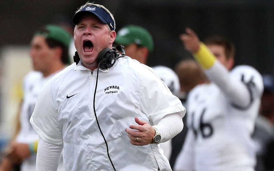 Nevada head coach Brian Polian shouts at an official against Arizona in Reno, Nevada. Nevada athletic director Doug Knuth said the school was fining coach Brian Polian $10,000 for his sideline behavior, which resulted in two unsportsmanlike conduct penalties during a 44-20 loss on Sept. 12, 2015. The school also announced it would place an administration official on the sideline during games. Photo: Cathleen Allison /Associated Press / FR70203 AP