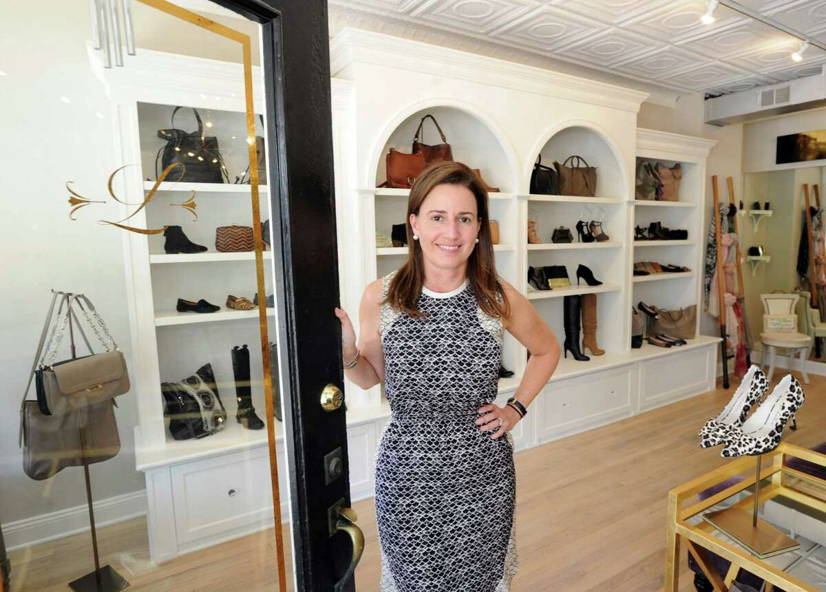 Audrey Aguilar, owner of Lily, a shoes and accessories store at 250 Sound Beach Ave., at the store in Old Greenwich. Aguilar just opened her store and named it after her daughter, Lily. Below, Lilly packages shoes.