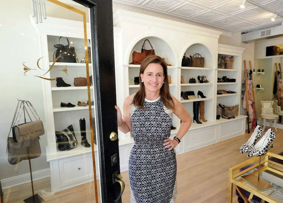 Audrey Aguilar, owner of Lily, a shoes and accessories store at 250 Sound Beach Ave., at the store in Old Greenwich. Aguilar just opened her store and named it after her daughter, Lily. Below, Lilly packages shoes. Photo: Bob Luckey Jr. / Hearst Connecticut Media / Greenwich Time