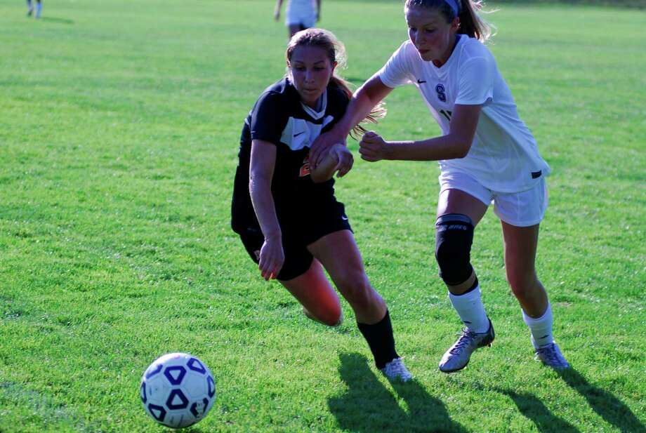 Staples and Ridgefield battle for possession during a girls soccer game in Westport, Connecticut on Friday, Sept. 18th 2015. Photo: Ryan Lacey/Staff Photo / Westport News Contributed