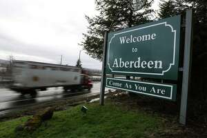 A sign welcomes visitors to Aberdeen during the first annual Kurt Cobain Day on Thursday, February 20, 2014 in Aberdeen, Wash. The town formally recognized Cobain with a new statue and exhibit at the Aberdeen Museum of History. (Joshua Trujillo, seattlepi.com)