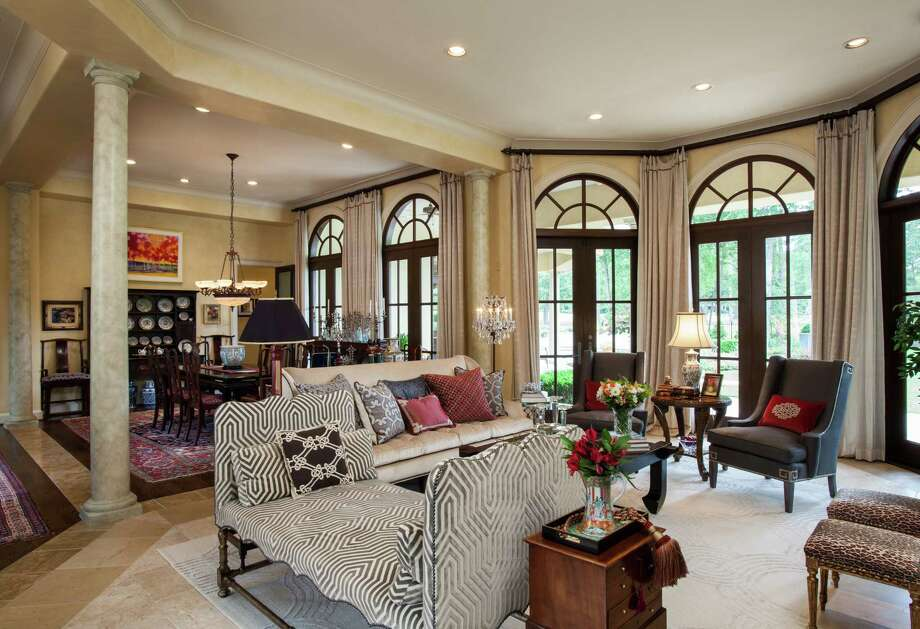 The upholstered furniture, pillows and rug were all custom-made for the Johnsons' formal living room, an open space in the center of the house. Photo: Brian Bookwalter