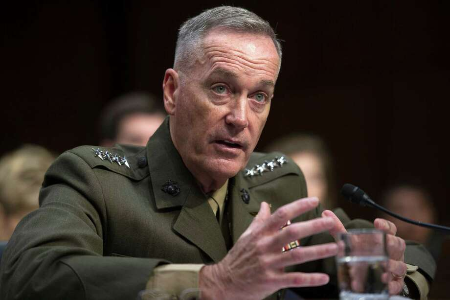 FILE - In this July 9, 2015, file photo, then-Marine Corps Commandant Gen. Joseph Dunford, Jr., testifies during his Senate Armed Services Committee confirmation hearing to become the Chairman of the Joint Chiefs of Staff, on Capitol Hill in Washington. The Marine Corps is expected to ask that women not be allowed to compete for several front-line combat jobs, inflaming tensions between Navy and Marine leaders, U.S. officials say. The tentative decision has ignited a debate over whether Navy Secretary Ray Mabus can veto any Marine Corps proposal to prohibit women from serving in certain infantry and reconnaissance positions. And it puts Dunford, the Marine Corps commandant who takes over soon as chairman of the Joint Chiefs of Staff, at odds with the other three military services, who are expected to open all of their combat jobs to women. (AP Photo/Cliff Owen, File) Photo: Cliff Owen, FRE / FR170079 AP