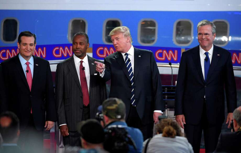 Republican presidential candidates, from left, Sen. Ted Cruz, Ben Carson, Donald Trump, and former Florida Gov. Jeb Bush pose for a group picture during the CNN Republican presidential debate at the Ronald Reagan Presidential Library and Museum, Wednesday, Sept. 16, 2015, in Simi Valley, Calif. (AP Photo/Mark J. Terrill) Photo: Mark J. Terrill, STF / AP