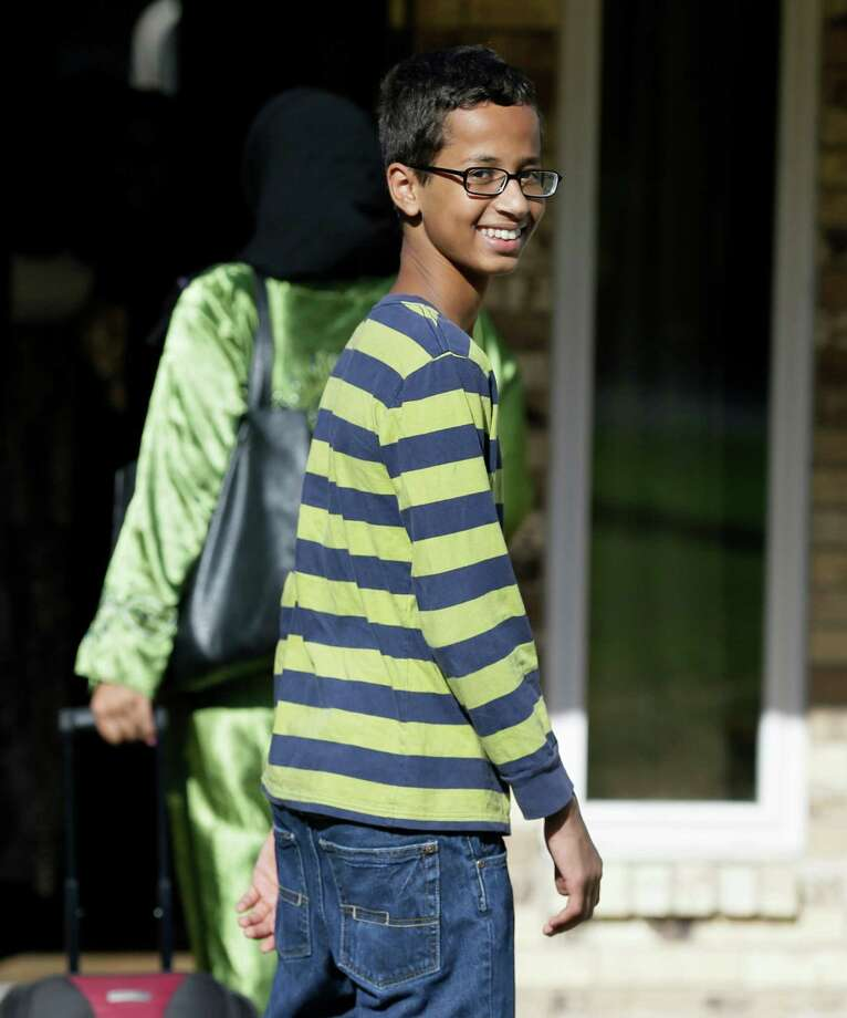 Ahmed Mohamed, 14, smiles as he arrives to his family's home in Irving, Texas, Thursday, Sept. 17, 2015.  Ahmed was arrested Monday at his school after a teacher thought a homemade clock he built was a bomb. He remains suspended and said he will not return to classes at MacArthur High School. (AP Photo/LM Otero) Photo: LM Otero, STF / AP