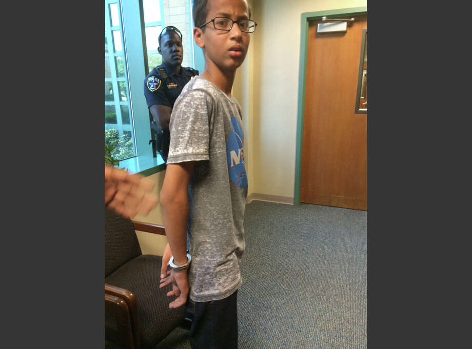 Ahmed Mohamed stands in handcuffs at Irving police department. Photo: Eyman Mohamed, HONS / Eyman Mohamed