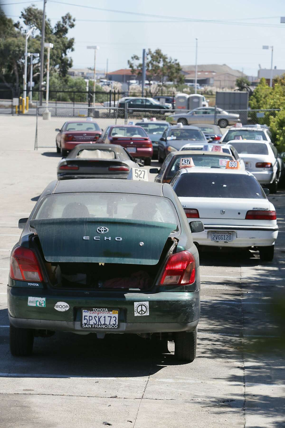 A car that was stolen (foreground) sits in a lot with other impounded vehicles at the Auto Return Bayshore Long Term Facility on Friday, September 18, 2015 in San Francisco, Calif.