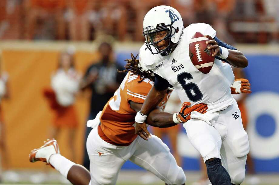 Rice quarterback Driphus Jackson (6) fends off Texas linebacker Anthony Wheeler at Royal-Memorial Stadium in Austin, Texas, on Saturday, Sept. 12, 2015. The host Longhorns won, 42-28. (Jay Janner/Austin American-Statesman/TNS) Photo: Jay Janner, MBR / Austin American-Statesman