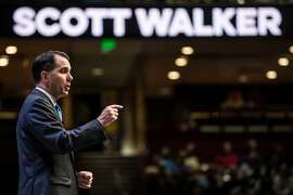 GREENVILLE, SC - SEPTEMBER 18:  Wisconsin Governor and republican presidential candidate Scott Walker speaks to voters at the Heritage Action Presidential Candidate Forum September 18, 2015 in Greenville, South Carolina. Eleven republican candidates each had twenty five minutes to talk to voters Friday at the Bons Secours Wellness arena in the upstate of South Carolina. (Photo by Sean Rayford/Getty Images)