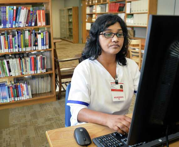 Samaritan School of Nursing student Vera Persaud of Schenectady works in the library of  their new school facilities at St. Mary's Hospital Friday Sept. 18, 2015 in Troy, NY.  (John Carl D'Annibale / Times Union) Photo: John Carl D'Annibale / 00033415A