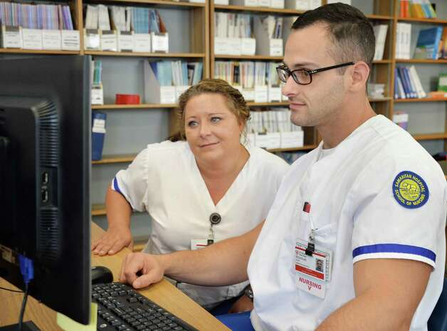 Samaritan School of Nursing students Nicol Taylor, left, of Scotia and Nick Elia of West Sand Lake in the library of  their new school facilities at Mary's Hospital Friday Sept. 18, 2015 in Troy, NY.  (John Carl D'Annibale / Times Union) Photo: John Carl D'Annibale / 00033415A