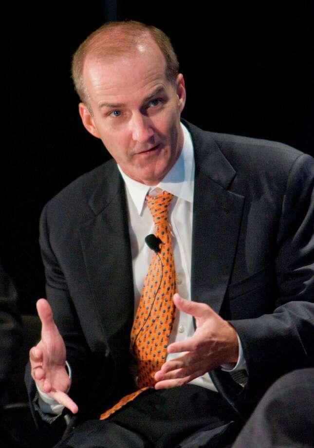 "NRG Energy CEO David Crane says renewable businesses, especially solar, ""act as a drag on NRG stock.""   ( Steve Campbell / Houston Chronicle) Photo: Steve Campbell, Staff Photographer / Houston Chronicle"