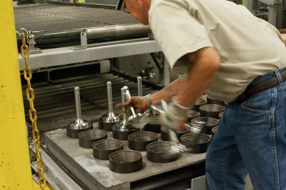 Parts for  pumps are gathered at a Fort Worth manufacturing facility. Manufacturing lost 5,600 jobs. Photo: Houston Chronicle File Photo / 2014 Houston Chronicle