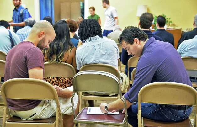"""Alex Cresswell, left, of Guilderland and Nathan Bristol of Wynantskill fill out applications during an open casting call for the independent film project """"Weightless"""" at Fellowship Hall Friday Sept. 18, 2015 in Troy, NY.  (John Carl D'Annibale / Times Union) Photo: John Carl D'Annibale / 00033187A"""